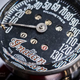 Deatils close up photo of tachometer of vintage Indian Four 1930